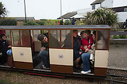 Passengers waiting for Broken down steam train, Hastings seafront,  East Sussex for the May Bank Holiday. 2 May 2016