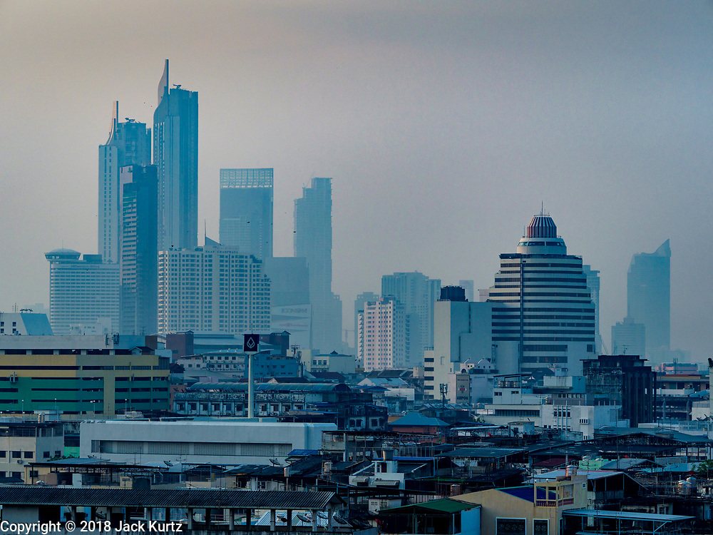 15 NOVEMBER 2018 - BANGKOK, THAILAND: The Bangkok skyline seen from the top of Wat Saket. Wat Saket is on a man-made hill in the historic section of Bangkok. The temple has golden spire that is 260 feet high, which was the highest point in Bangkok for more than 100 years. The temple construction began in the 1800s during the reign of King Rama III and was completed in the reign of King Rama IV. PHOTO BY JACK KURTZ