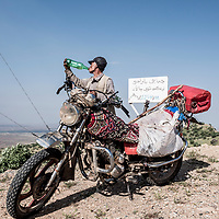 A shepherd and his motorbike photographed in Kurdistan, Northern Iraq, 2019.