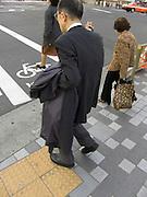 elderly people crossing a street Tokyo Japan