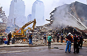 """NEW YORK, NY: Smoke rises from the rubble while recovery workers clear wreckage and look for evidence and bodies at """"Ground Zero"""" of the World Trade Center complex after the WTC terrorist attack, Sept. 22, 2001, eleven days after the attack. Almost 3,000 people were killed when terrorists crashed hijacked passenger jets into the twin towers. PHOTO BY JACK KURTZ"""