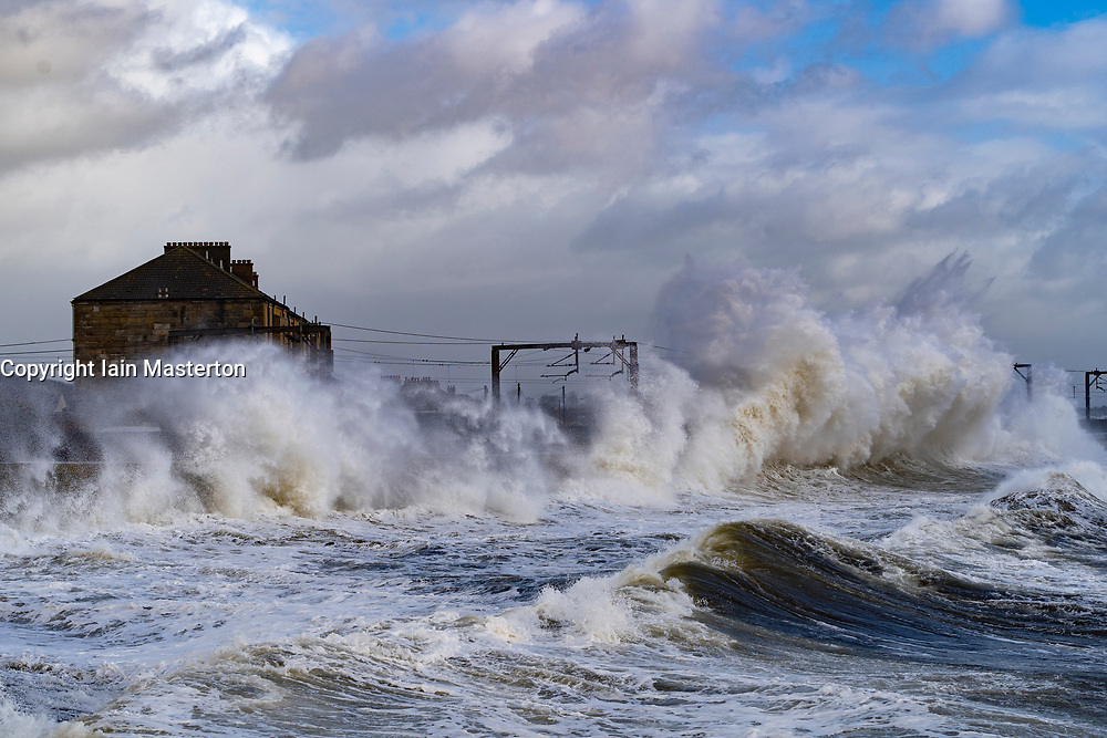 Saltcoats, Scotland, UK. 9 February, 2020.  Storm Ciara creates large waves breaking over seawall at Saltcoats in Ayrshire. Train services on the adjacent railway have been interrupted. With high tide due at midday and winds expected to increase in speed later in the day, the height of the waves are expected to dramatically increase. Iain Masterton/Alamy Live News.