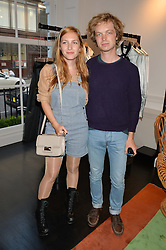Siblings JOSEPHINE DE LA BAUME and ALEXANDRE DE LA BAUME at the launch of the new Marina Rinaldi flagship store at 5 Albemarle Street, London on 3rd July 2014.