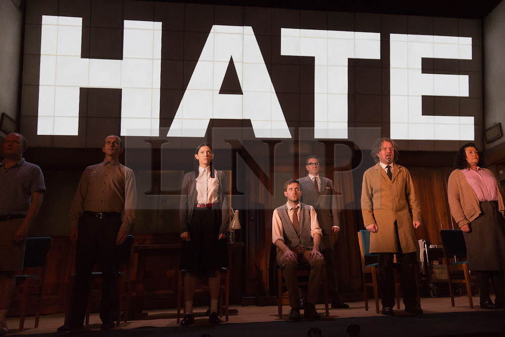 """© Licensed to London News Pictures. 08/05/2014. London, England. Pictured: Cast with Sam Crane as Winston (grey waistcoat) and Tim Dutton as O'Brien (centre right) during the Two Minutes Hate. The Play """"1984"""" by George Orwell transfers to the Playhouse Theatre until 19 July 2014. A new adaptation for the stage by Robert Icke and Duncan MacMillan. With Sam Crane as Winston Smith. Photo credit: Bettina Strenske/LNP"""