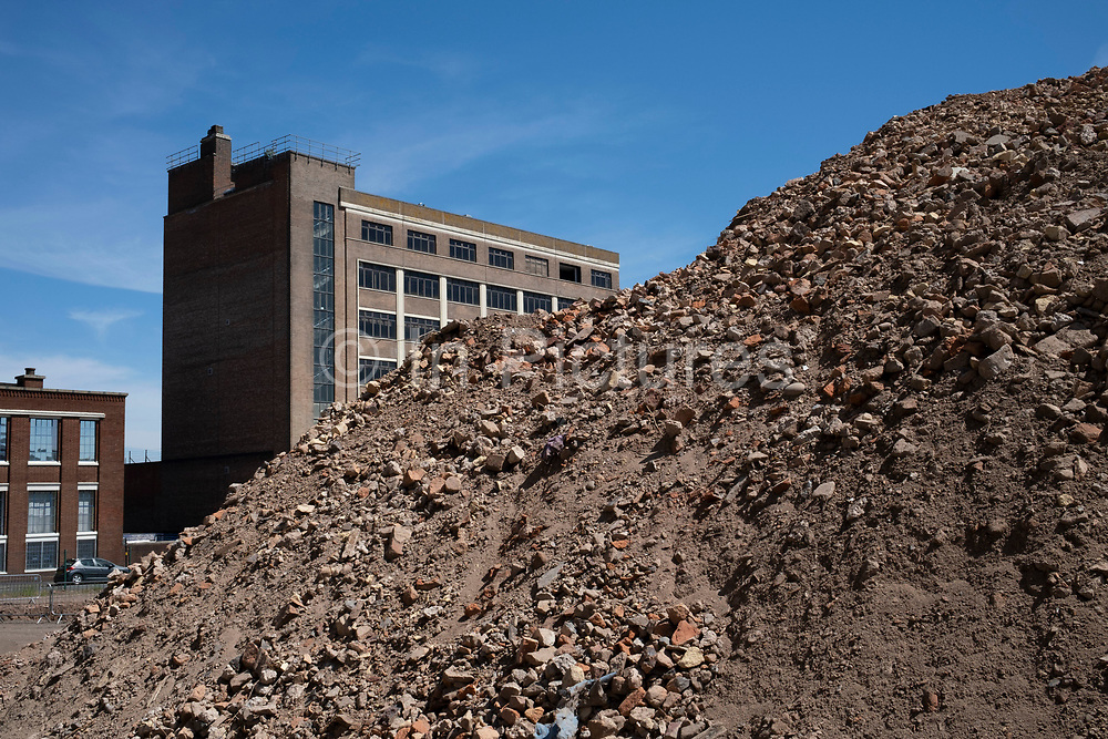 Huge pile of bricks as part of a development / redevelopment of old industrial builindgs in the city centre on 20th May 2020 in Birmingham, United Kingdom. The city is under a long term and major redevelopment, with much of its industrial past being demolished and made into new flats for residential homes.