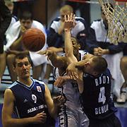 GERMANY...l<br /> EUROLEAGUE Efes Pilsen - Alba Berlin Basketball match. Alba Berlin's Teoman Ozturk (L) with Efes Pilsen's Marcus Brown (C), Henrik Rodl (R) during their Abdi Ipekci Sports Hall in ISTANBUL at TURKEY.<br /> Photo by AYKUT AKICI/TurkSporFoto