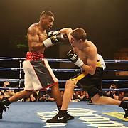 "Vitali Kopylenko (black shorts) fights Willie Monroe Jr. (white) during the ESPN ""Boxcino"" boxing tournament at Turning Stone Resort Casino on Friday, April 18, 2014 in Verona, New York.  (AP Photo/Alex Menendez)"