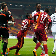 Galatasaray's Burak Yilmaz (F) Kasimpasaspor's Ryan Donk (B) during their Turkish Super League soccer match Galatasaray between Kasimpasaspor at the TT Arena at Seyrantepe in Istanbul Turkey on Friday, 31 October 2014. Photo by Kurtulus YILMAZ/TURKPIX