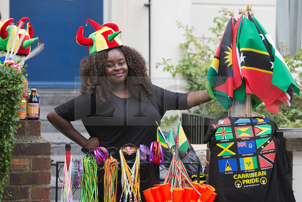 © Licensed to London News Pictures. 27/08/2012 London, England. Pictured: Street Vendor. Notting Hill Carnival 2012, the largest street festival in Europe, gets its parade on Adults' Day under way. Photo credit: Bettina Strenske/LNP
