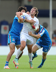 Daniel Bibby of England is challenged by Flippo Guarducci (left) and Steven David Castle of Italy - Photo mandatory by-line: Dougie Allward/JMP - Mobile: 07966 386802 - 11/07/2015 - SPORT - Rugby - Exeter - Sandy Park - European Grand Prix 7s