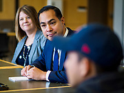 15 APRIL 2019 - DES MOINES, IOWA: JULIÁN CASTRO (center) and TASCHA BROWN, Director of Central Campus, (left) listen to students describe their experiences at the Skilled Trades Alliance, during Castro's visit the Central Campus Skilled Trades Alliance at the Des Moines Public School's Central Campus Monday. Castro is on his third visit to Iowa since declaring his candidacy for the Democratic ticket of the US Presidency. Casto talked to students and administrators about skilled trades education and toured the campus. Iowa traditionally hosts the the first selection event of the presidential election cycle. The Iowa Caucuses will be on Feb. 3, 2020.               PHOTO BY JACK KURTZ