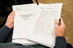 "© Licensed to London News Pictures. 27/11/2019. London, UK. A journalist holds revealing official government documents showing the US is demanding that the NHS will be ""on the table"" in talks on a post-Brexit trade deal on the National Health Service. Photo credit: Ray Tang/LNP"