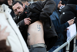 "© Licensed to London News Pictures . 26/11/2016 . Bolton , UK . A man pictured exposing a swastika tattoo on his flank , amongst those opposed to the mosque , at the demonstration . Approximately 100 people attend a demonstration against the construction of mosques in Bolton , under the banner "" No More Mosques "" , organised by a coalition of far-right organisations and approximately 150 anti fascists opposing the demonstration , in Victoria Square in Bolton Town Centre . Photo credit : Joel Goodman/LNP"