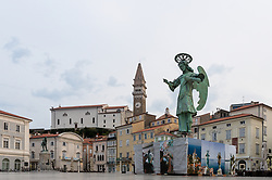 After two months of restoration, the Archangel Michael's statue, made of copper plate, returned to Piran. The image shows view of the Statue of Archangel Michael and St. George's Parish Church before helicopter placing it on top of the church's clock, on October 15, 2018 in Piran, Slovenia. Photo by Matic Klansek Velej / Sportida