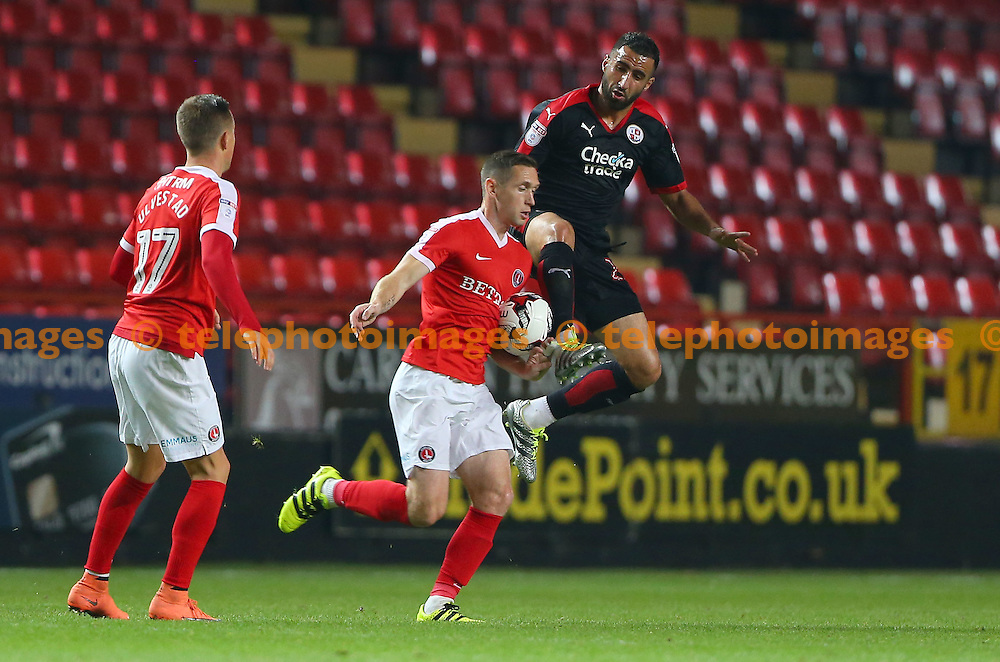 Crawley's Aryan Tajbakhsh makes a challenge during the Checkatrade Trophy match between Charlton Athletic and Crawley Town at The Valley in London. October 4, 2016.<br /> James Boardman / Telephoto Images<br /> +44 7967 642437