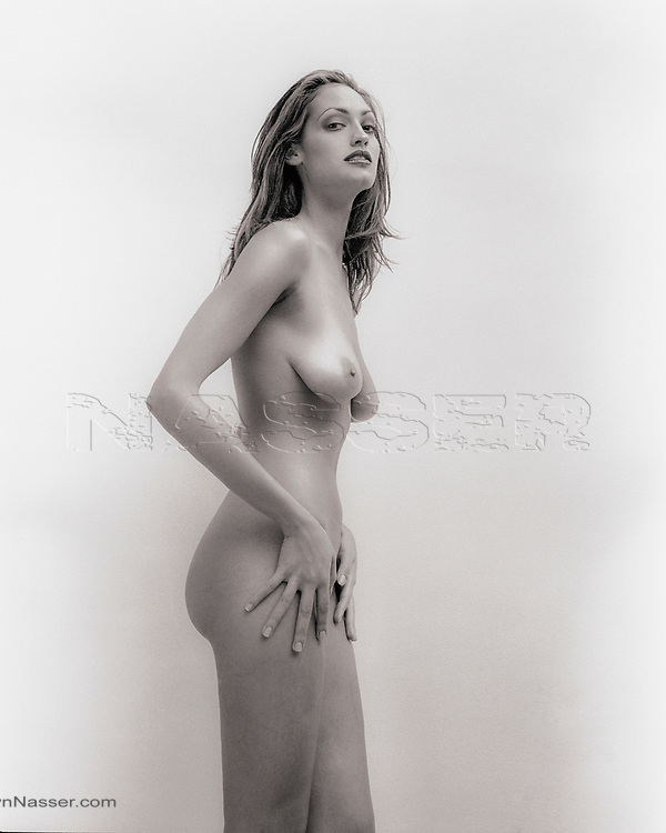 Nude Editorial TALL GIRL Tag Magazine. Model Michelle Norkett. <br /> TALL GIRL PLATINUM, The White Wall, New York. <br /> Shot in the studio with a Pentax 6x7 film camera and Kodak Tri-X 220 Film Pushed Process Plus 1.5 for Bromide Gallerie Paper.