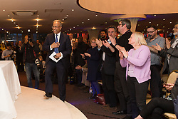 © Licensed to London News Pictures. 01/05/2015. London, UK. Ex Mayor of Tower Hamlets, Lutfur Rahman is welcomed by a cheering crowd as he takes the stage at a public meeting held at the Waterlily in Stepney, east London on 30th April 2015. The meeting was ex Mayor of Tower Hamlets, Lutfur Rahman's first public appearance after being found guilty of electoral fraud last week and called for attendees to donate money to a legal fund to facilitate an appeal against the High Court ruling. Photo credit : Vickie Flores/LNP