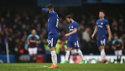 Chelsea's Eden Hazard (centre) looking dejected during the Premier League match at Stamford Bridge, London.