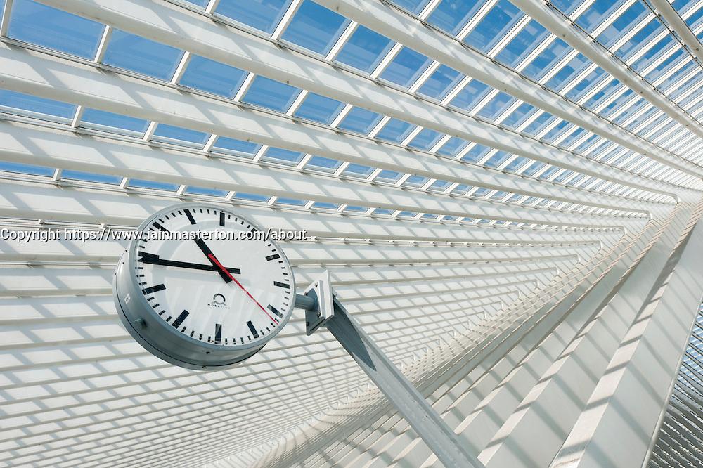 Clock detail inside Liège-Guillemins modern railway station designed by architect Santiago Calatrava  in Liege Belgium