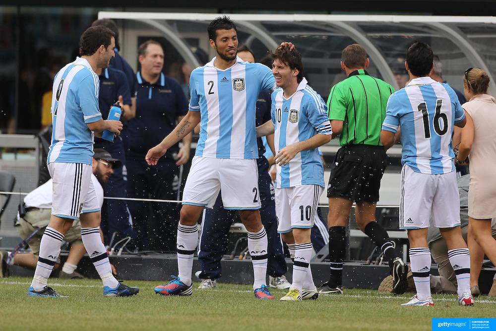 Lionel Messi, Argentina, celebrates his hat trick with team mate Ezequiel Garay during the Brazil V Argentina International Football Friendly match at MetLife Stadium, East Rutherford, New Jersey, USA. 9th June 2012. Photo Tim Clayton