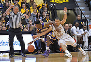 WICHITA, KS - JANUARY 05:  Guard Fred VanVleet #23 of the Wichita State Shockers battles for the ball with guard Wes Washpun #11 of the Northern Iowa Panthers during the first half on January 5, 2014 at Charles Koch Arena in Wichita, Kansas.  (Photo by Peter Aiken/Getty Images) *** Local Caption *** Fred VanVleet;Wes Washpun