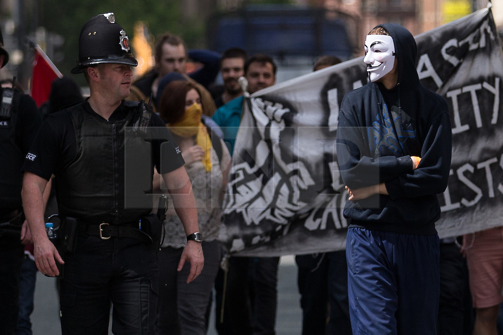 """© Licensed to London News Pictures . 23/05/2015 . Manchester , UK . A group of protesters peel away from the Piccadilly Gardens and march impromptu along Princess Street . A demonstration , organised by """" The People's Assembly """" , against austerity in Piccadilly Gardens in Central Manchester , attended by approximately 2000 people . Photo credit : Joel Goodman/LNP"""