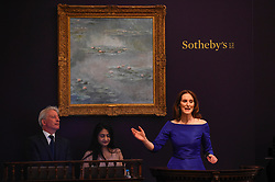 © Licensed to London News Pictures. 19/06/2019. LONDON, UK. Auctioneer Helena Newman fields bids for ''Nymphéas'' by Claude Monet, (Est. £25,000,000 - 35,000,000) which sold for a hammer price of £21,000,000 at Sotheby's Impressionist & Modern art evening sale in New Bond Street. This is the first major evening sale to take place after Sotheby's agreed to a takeover by media and telecoms billionaire Patrick Drahi in a deal valued at $3.7bn (£2.9bn).  The big five global auction houses (Sotheby's, Christie's, Bonhams, Phillips and China Guardian Auctions) will now be held privately.  Francois Pinault, another French billionaire, owns Sotheby's traditional rival Christie's.   Photo credit: Stephen Chung/LNP