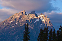Sunrise over the Cathedral Group.  Three of the highest peaks of the Teton Range.  Grand Teton National Park, Wyoming, USA.