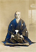 vintage studio style portrait of monk Japan 1900s