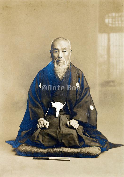 vintage studio style portrait of monk Japan 1900s