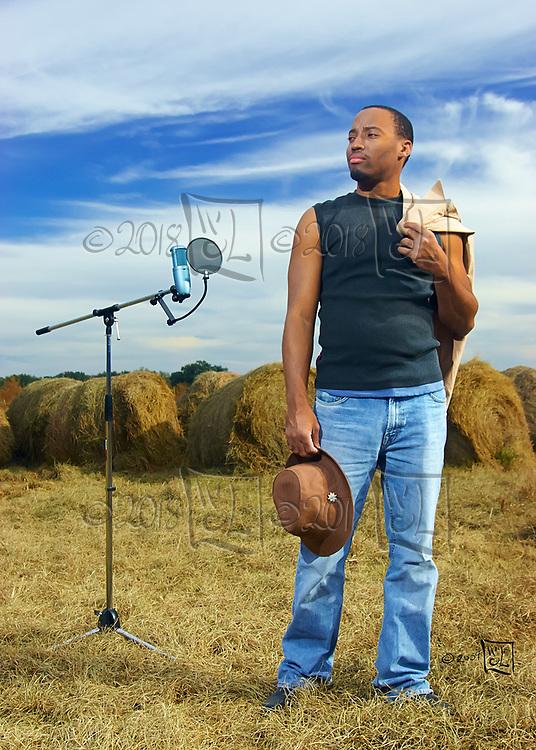 Songwriter Claude in hayfield