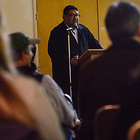 Milton Bluehouse introduces other presenters during an EPA meeting Thursday in Grants.