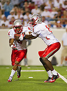 Sep 10, 2011; Little Rock, AR, USA; New Mexico Lobos quarterback Tarean Austin (8) hands the ball to running back Demarcus Rogers (4) during the second half of a game against the Arkansas Razorbacks at War Memorial Stadium. The Razorbacks beat the Lobos 52-3. Mandatory Credit: Beth Hall-US PRESSWIRE