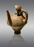 Terra cotta side spouted pitcher with lid - 1700 BC to 1500 BC - Kültepe Kanesh - Museum of Anatolian Civilisations, Ankara, Turkey. Against a grey  background