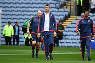 Brentford Manager Marinus Dijkhuizen makes his way to the dugout prior to kick off. Skybet football league championship match, Burnley  v Brentford at Turf Moor in Burnley, Lancs on Saturday 22nd August 2015.<br /> pic by Chris Stading, Andrew Orchard sports photography.