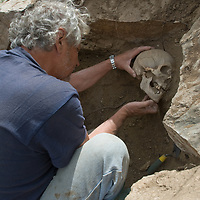 Smithsonian archaeologist & forensics specialist, Dr. Bruno Frohlich, unearths a bronze-age skeleton at site above Delger River near Muren.  The skull may be 2700+ years old.