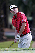 May 9, 2014; Ponte Vedra Beach, FL, USA; Russell Henley chips up to the 1st green during the second round of The Players Championship at TPC Sawgrass - Stadium Course. Mandatory Credit: Peter Casey Mercer-USA TODAY Sports