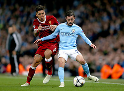 Liverpool's Roberto Firmino (left) and Manchester City's Bernardo Silva (right) battle for the ball during the UEFA Champions League, Quarter Final at the Etihad Stadium, Manchester.