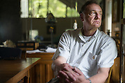 BIRMINGHAM, AL – JUNE 26, 2015: Louie Henry drinks his morning coffee in his Inverness home, just outside of Birmingham. In May of 2015 a background check conducted by Henry's employer revealed a prior conviction for falsely reporting a delinquent loan while Henry worked in the banking industry. Despite it being 14 years since the relatively minor incident, Henry lost his position as a sales-manager at the local medical-technology company after one day on the job. CREDIT: Bob Miller for The Wall Street Journal<br /> RESTRICT