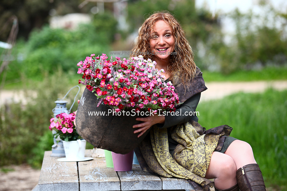 Excited Woman works in her garden