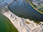 Nederland, Flevoland, Markermeer, 26-08-2019; Marker Wadden in het Markermeer. Westkust met duinen en vogel kijktoren (met rood dak), nabij de haven.<br /> Doel van het project van Natuurmonumenten en Rijkswaterstaat is natuurherstel, met name verbetering van de ecologie in het gebied, in het bijzonder de kwaliteit van bodem en water<br /> Naast het hoofdeiland is er inmiddels een tweede eiland in wording, de uiteindelijk Marker Wadden archipel zal uit vijf eilanden bestaan. <br /> Marker Wadden, artifial islands. The aim of the project is to restore the ecology in the area, in particular the quality of soil and water.<br /> The first phase of the construction, the main island, is finished. <br /> <br /> luchtfoto (toeslag op standard tarieven);<br /> aerial photo (additional fee required);<br /> copyright foto/photo Siebe Swart
