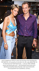 LADY ISABELLA HERVEY and her brother the MARQUESS OF BRISTOL, at a party in London on 4th July 2002.	PBS 12