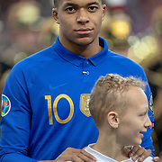 PARIS, FRANCE - March 25:  Kylian Mbappé #10 of France lines up with the French team during the National Anthems before the France V Iceland, 2020 European Championship Qualifying, Group Stage at  Stade de France on March 25th 2019 in Paris, France (Photo by Tim Clayton/Corbis via Getty Images)