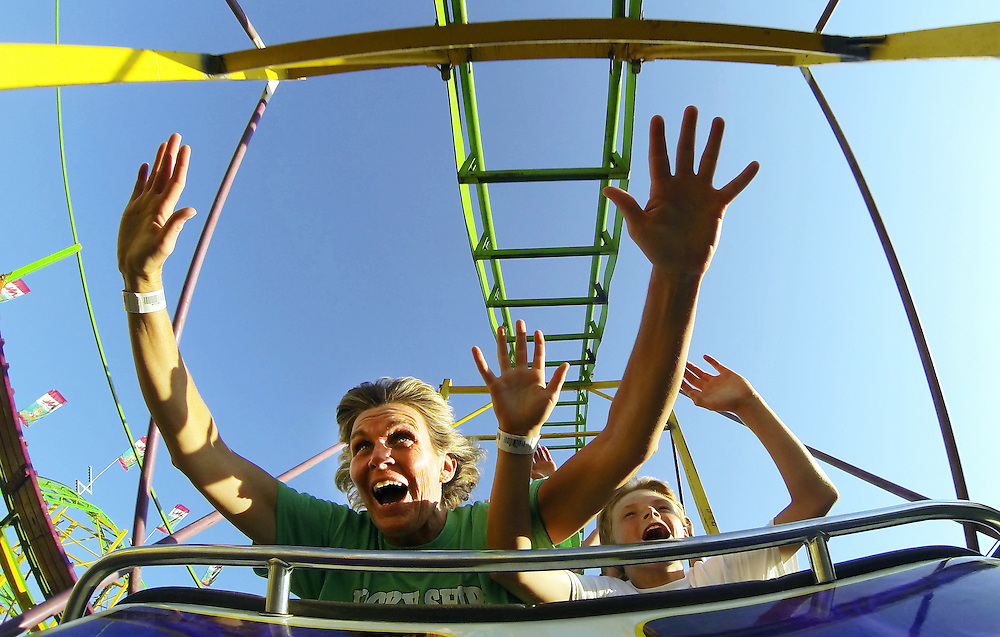 Cyndi Hayes and her son Colby, 11, enjoy the crazy cat coster Friday in the Midway at the Nebraska State Fair in Grand Island. (Independent/Matt Dixon)