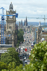 View along Edinburgh's Princes Street with the Clock Tower of the Balmoral Hotel left of centre and the spires of St Mary's Cathedral seen from Calton Hill, at the far end of Princes Street, in the picture from July 2004..Pic ©2010 Michael Schofield. All Rights Reserved.