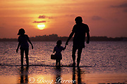 couple with child wading in Biscayne Bay at sunset, Miami, Florida, USA ( Western Atlantic Ocean ) MR 131 - 133