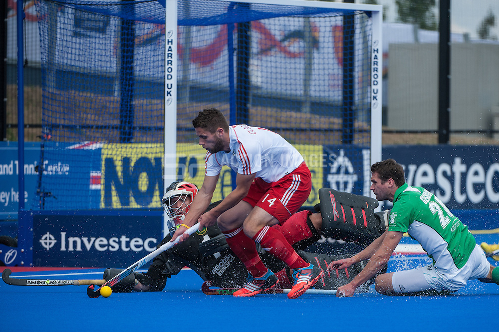 Mark Gleghorne of England is blocked by Ireland's David Harte. Investec London Cup Final, Lee Valley Hockey & Tennis Centre, London, UK on 13 July 2014. Photo: Simon Parker