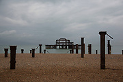 View along Brighton Beach and out to sea and the derelict West Pier, which burned down a few years ago. At this time of year on a cold day it is a desolate scene.