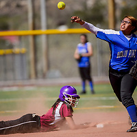Navajo Pine Warrior Cheyney Castillo (14) throws for home as Rehoboth Lynx Jessica Triplett (13) dives back to second base Thursday at Ford Canyon Park in Gallup.
