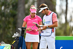 January 19, 2019 - Lake Buena Vista, FL, U.S. - LAKE BUENA VISTA, FL - JANUARY 19: Lexi Thompson of the United States consults with her caddie during the third round of the Diamond Resorts Tournament of Champions on January 19, 2019, at Tranquilo Golf Course at Fours Seasons Orlando in Lake Buena Vista, FL. (Photo by Roy K. Miller/Icon Sportswire) (Credit Image: © Roy K. Miller/Icon SMI via ZUMA Press)